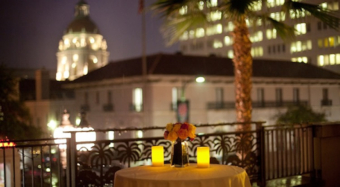 view of pasadena city hall from the sofia banquet hall balcony at night