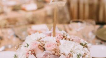 floral arrangement and table numbers ella banquet hall wedding