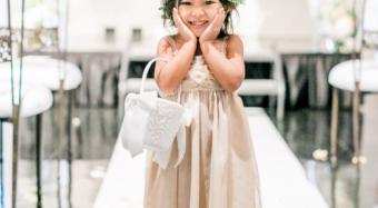 flower girl in the ella ballroom banquet hall at noor in los angeles