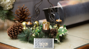 noor business cards with holiday decorations in the sofia banquet hall foyer