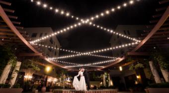 bride and groom portrait romantic wedding kiss stood on the fountain on the noor terrace pasadena