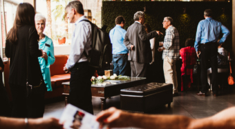 people talking at business networking event at noor los angeles