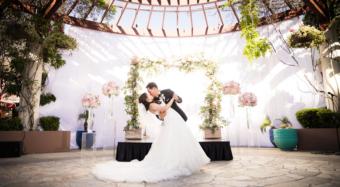 bride and groom dip kiss on the terrace at noor los angeles