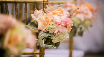 close up of gold chairs and floral details at a terrace wedding ceremony