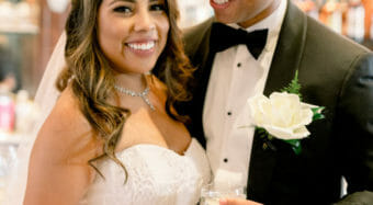 smiling bride and groom toasting each other after their wedding ceremony at noor los angeles