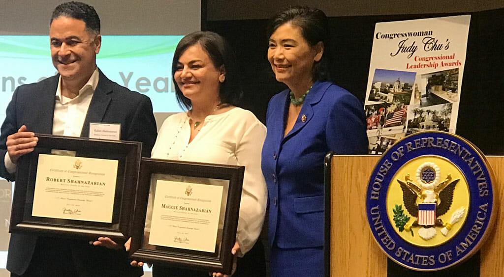 congresswoman judy chu presenting awards to robbert and maggie shahnazarian