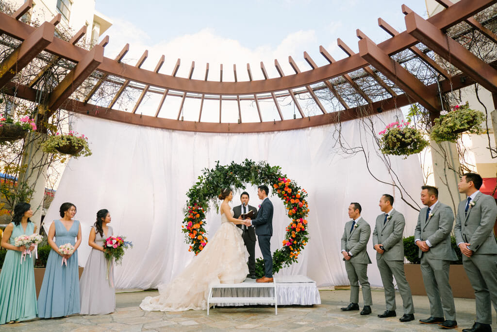 beautiful circular floral arch for wedding ceremony on the NOOR terrace