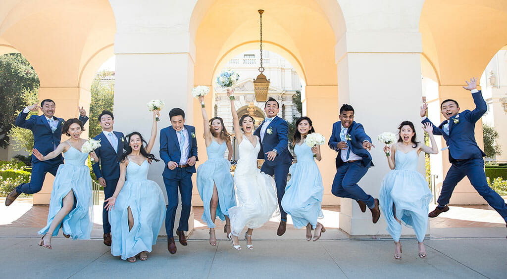 NOOR wedding party jumping for joy outside pasadena city hall