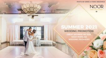 bride and groom dancing in los angeles banquet hall under a beautiful chandelier
