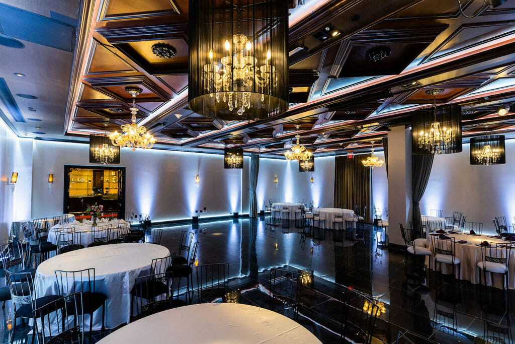 anniversary party venue the ella ballroom at NOOR los angeles with ghost chandeliers and porcelain floor